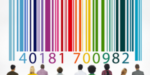 A group of people staring at a barcode and numbers on a wall.